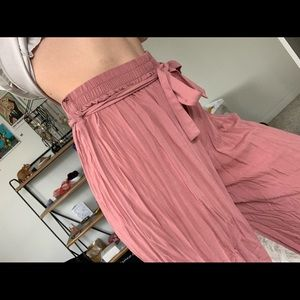 pink slinky pleated wide leg pants with a tie bow
